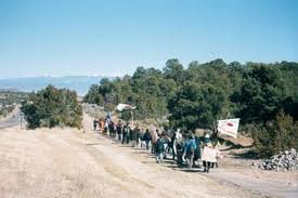 Pilgrims walk east from Los Alamos toward the Sangre de Christo Mountains.